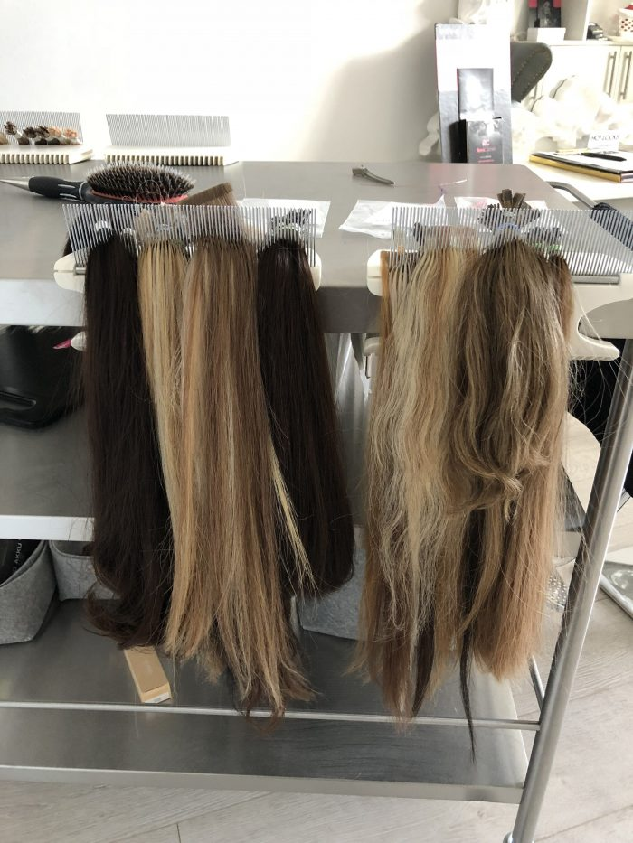 Four EasyStrands Hair Extensions Holders on one table